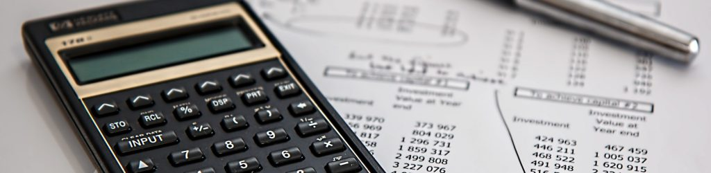 black-calculator-near-ballpoint-pen-on-white-printed-paper-53621